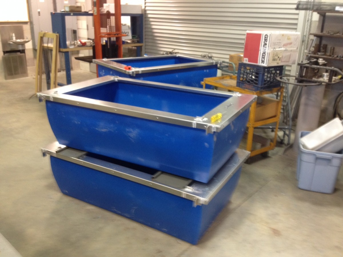 Gary and Bob welded aluminum frames around PVC tanks - our main rearing units